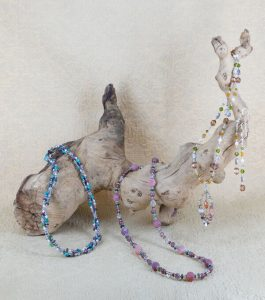 3-necklaces-on-wood